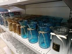 Stikla vāzes ziedi