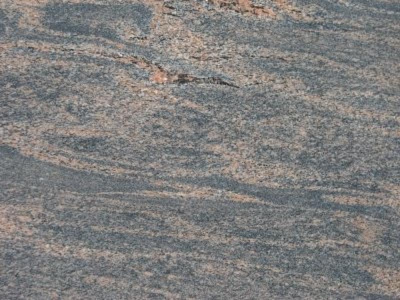 HallandiaarVredapelksarie sarkanu joslojumu granīta akmens