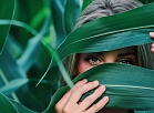 woman_covering_her_face_with_corn_leaves